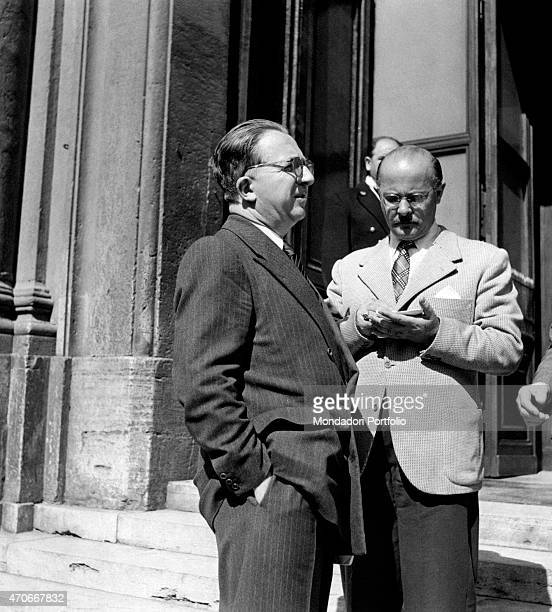 'The Italian minister Giuseppe Pella with pinstriped suit and his hands in pocket with the journalist Vittorio Statera Italy 1953 '
