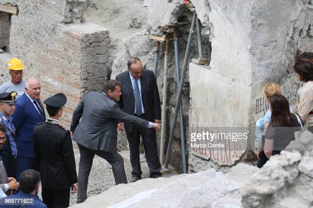 The Italian Minister of Cultural Heritage Alberto Bonisoli accompanied by superintendent Massimo Osanna who shows him the new inscription discovered...