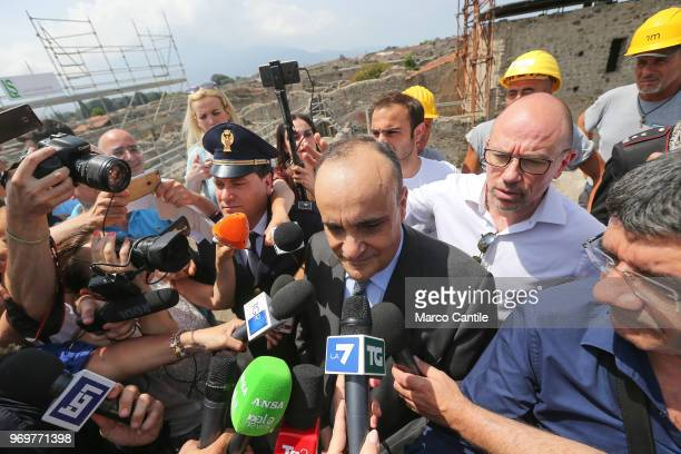 The Italian Minister of Cultural Heritage Alberto Bonisoli with journalists in one of the new excavations that are part of the Regio V site of the...