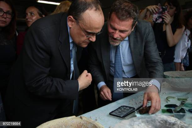 SCAVI POMPEI CAMPANIA ITALY The Italian Minister of Culture Alberto Bonisoli with director Massimo Osanna looks at pottery and coins found in the...