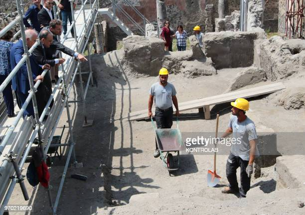 SCAVI POMPEI CAMPANIA ITALY The Italian Minister of Culture Alberto Bonisoli with director Massimo Osanna chat with restorers in The work site of new...