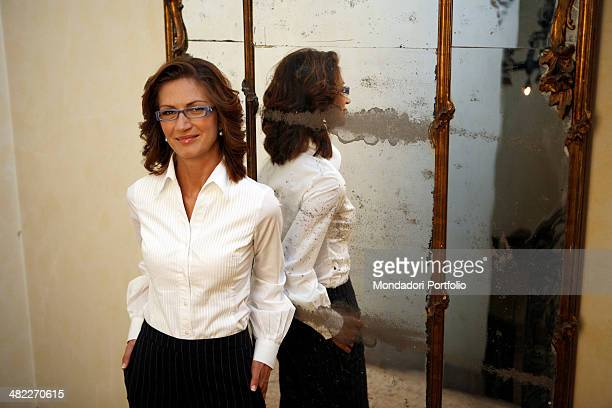 The Italian Minister of Education in the Berlusconi Cabinet IV Mariastella Gelmini poses in front of an antique mirror, smiling at the camera. Milan...