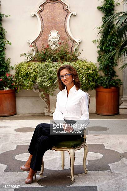 The Italian Minister of Education in the Berlusconi Cabinet IV Mariastella Gelmini poses sitting in a small inner garden with a building decoration...