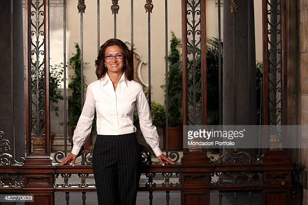 The Italian Minister of Education in the Berlusconi Cabinet IV Mariastella Gelmini poses smiling in front of a closed gate Milan August 25th 2008