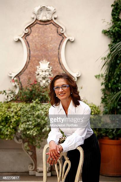 The Italian Minister of Education in the Berlusconi Cabinet IV Mariastella Gelmini poses with her arms on the seatback of a chair, smiling at the...