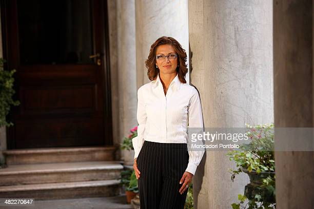 The Italian Minister of Education in the Berlusconi Cabinet IV Mariastella Gelmini posing next to the pillars that skirt the entrance of a dwelling...