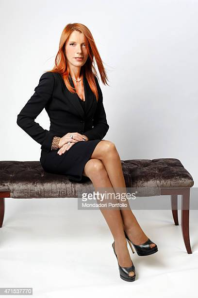 The Italian Minister of Tourism Michela Vittoria Brambilla poses for the photo shoot in Milan at the Savoia Hotel where she resides during her...