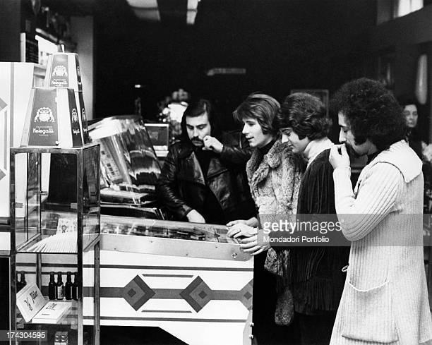 The Italian music band I Camaleonti are playing pinball in a cafè in Milan from left Paolo de Ceglie Gerardo Manzoli known as Gerry Antonio Cripezzi...