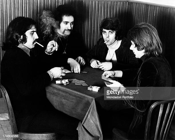 The Italian music band I Camaleonti playing cards in a cafè in Milan from left Paolo de Ceglie Livio Macchia Antonio Cripezzi known as Tonino Gerardo...