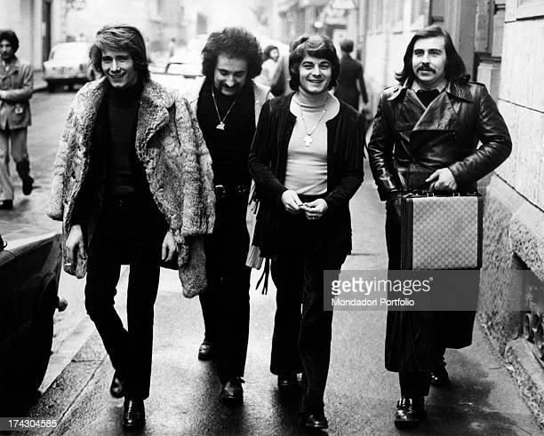 The Italian music band I Camaleonti taking a walk along the streets of Milan from left Gerardo Manzoli known as Gerry Livio Macchia Antonio Cripezzi...