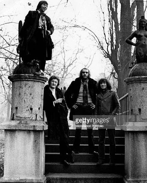 The Italian music group Equipe 84 next to the cast iron statues representing two mermaids of the Bridge of the Mermaids in the heart of Parco...