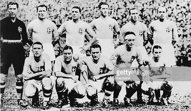 The Italian National Football Team line up before a game during the 1934 FIFA World Cup, Italy, 1934. Standing L - R; Gianpiero Combi , Luis Monti ,...