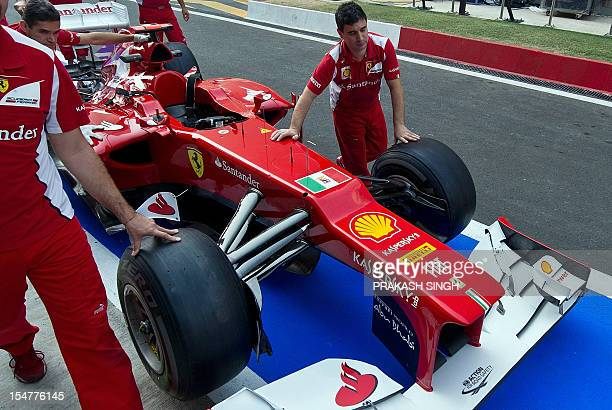 The Italian Navy ensign is seen in between the front wheels of Ferrari driver Fernando Alonso of Spain's car during the first practice session at The...
