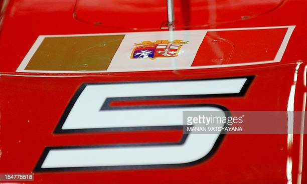 The Italian Navy ensign is seen on the car of Ferrari driver Fernando Alonso of Spain during the first practice session at the Buddh International...