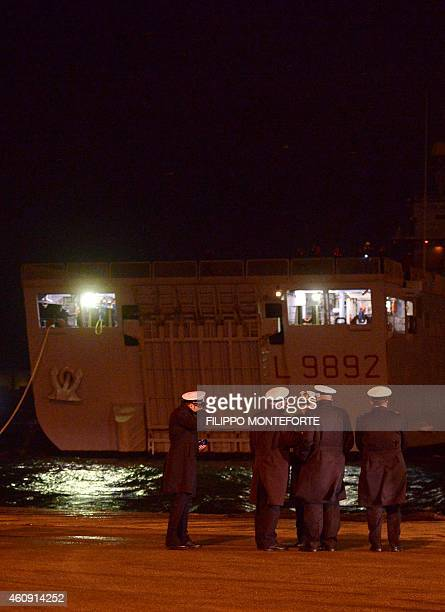 The Italian Navy San Giorgio with rescued passengers of the Norman Atlantic ferry arrives in Brindisi southern Italy on December 30 2014 Eleven...