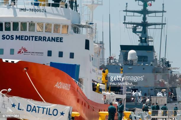The Italian navy ship Orione docks behind the Aquarius rescue ship and the Italian coast guard boat the Dattilo at Valencia´s port on June 17 2018...