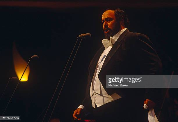 The Italian operatic tenor Luciano Pavarotti performs in London during the free Party in the Park concert to celebrate his 30 years in opera. A crowd...