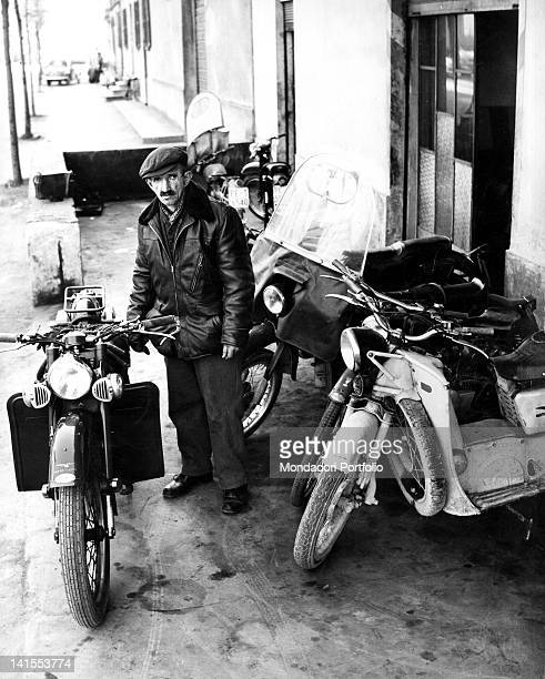 The Italian painter Antonio Ligabue posing among his motorcycles. Reggio Emilia, March 1961