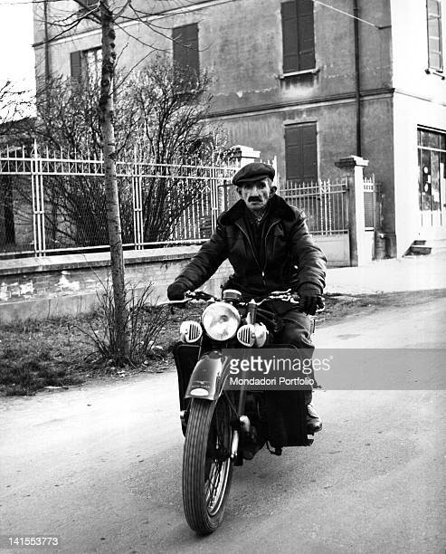The Italian painter Antonio Ligabue riding his favourite motorcycle: a Moto Guzzi 500. Reggio Emilia, March 1961