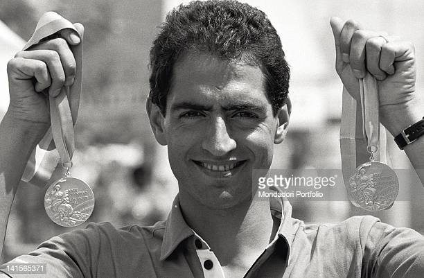 The Italian pentathlete Daniele Masala showing the two gold medals won at the Olympics Los Angeles August 1984