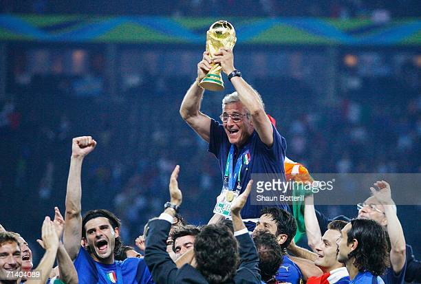 The Italian players celebrate as Marcello Lippi the coach of Italy lifts the World Cup trophy aloft following his team's victory in a penalty...
