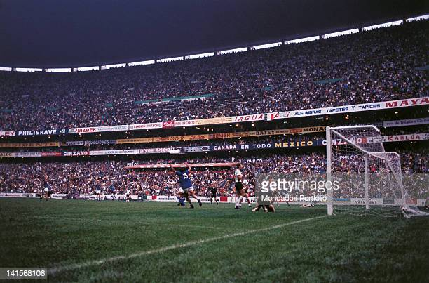 The Italian players rejoice after Gianni Rivera has put the fourth goal into the net in the semi final of the World Cup Championship played between...