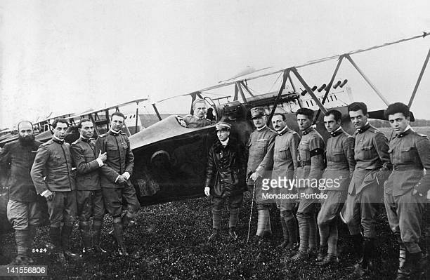 The Italian poet and writer Gabriele D'Annunzio posing with the pilots of the flight on Vienna 1918