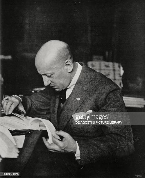 The Italian poet Gabriele D'Annunzio in the study at his Vittoriale degli Italiani estate Gardone Riviera Italy from L'Illustrazione Italiana Year...