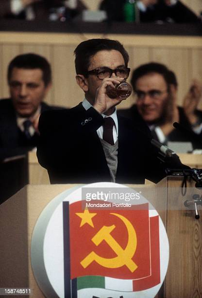 The Italian politician and secretary of the Italian Communist Party drinking something at a meeting Italy 1984