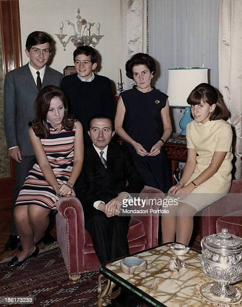 The Italian politician Giulio Andreotti in his Roman residence sitting in an armchair next to his wife Livia Danese and children Serena Stefano...