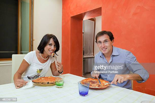 The Italian politician Nunzia De Girolam eats a pizza with her boyfriend the italian politician Francesco Boccia 2011