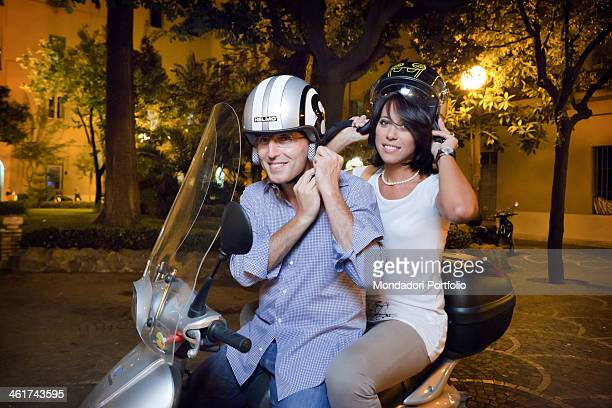 the Italian politician Nunzia De Girolamo and her boyfriend the italian politician Marco Bocca on a scooter Rome Italy april 2011