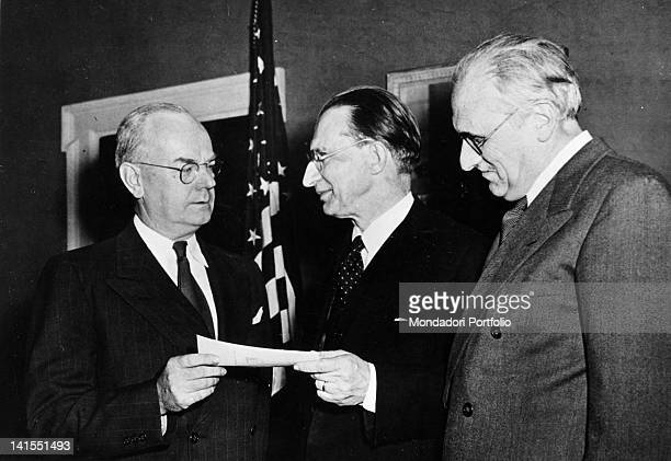 The Italian President of the Council Alcide De Gasperi receiving a cheque for 50000 dollars from the US Treasury Secretary John W Snyder and the...