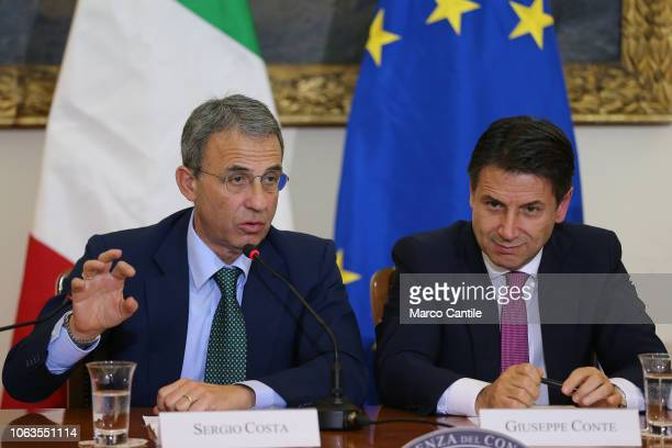 The Italian President of the Council Giuseppe Conte with the italian minister Sergio Costa during the press conference for the Land of Fires at the...