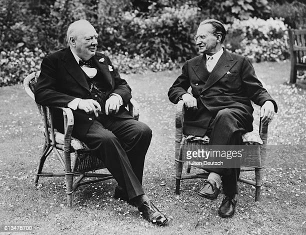 The Italian Prime Minister Alcide Gasperi sits chatting to the British leader Sir Winston Churchill in the garden of 10 Downing Street