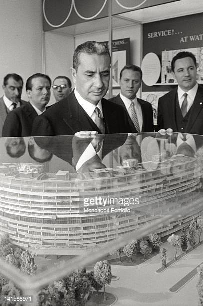 The Italian Prime Minister Aldo Moro looking a scale model Washington April 1965