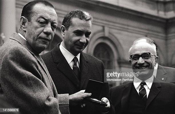 The Italian Prime Minister Aldo Moro receiving a medal from the Mayor of New York Robert Wagner Jr while the Italian Minister of Foreign Affairs...