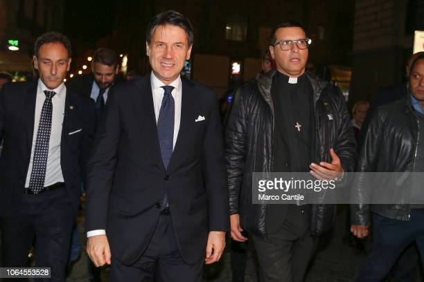 The Italian Prime Minister Giuseppe Conte visiting the Forcella district of Naples with the priest Merola