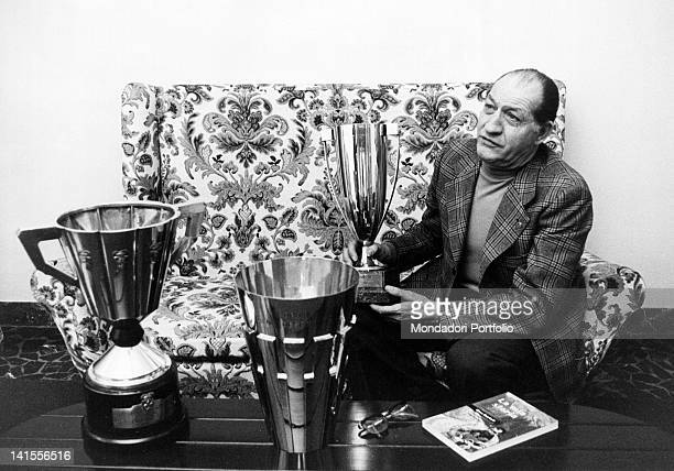 The Italian racing cyclist Gino Bartali showing some of the trophies won during his career Florence April 1975