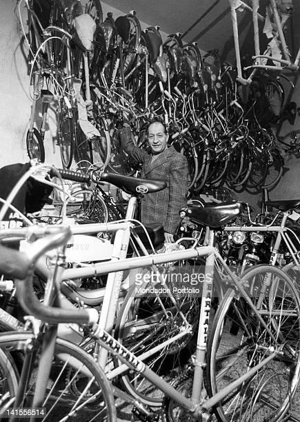 The Italian racing cyclist Gino Bartali standing among bicycles Florence April 1975