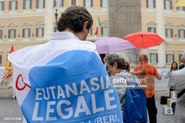 The Italian Radicals and the Luca Coscioni association protest in front of the Chamber of Deputies to ask for discussion in Parliament in favour of...