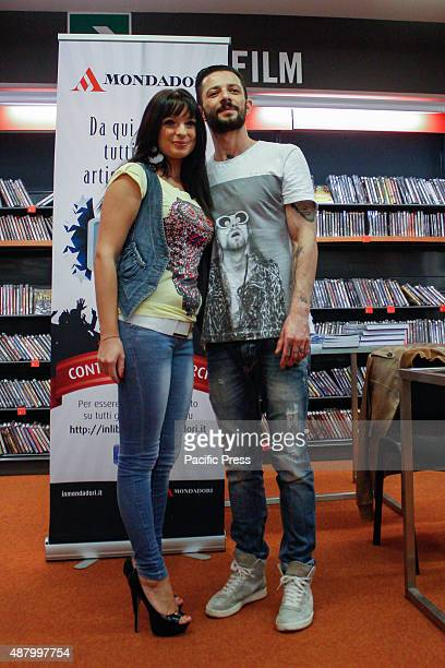 """The Italian rapper and songwriter Francesco Tarducci, also known as """"Nesli"""", poses with his fan during his fans day at Mondadori bookshop to sign..."""