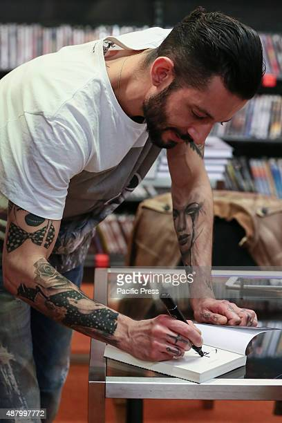 """The Italian rapper and songwriter Francesco Tarducci, also known as """"Nesli"""", signs autograph of his first novel titled """"Andrà tutto bene"""". At..."""