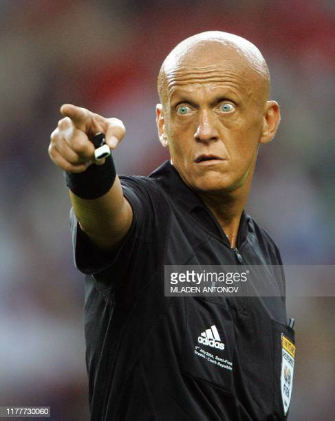 The Italian referee Pierluigi Collina gestures 01 July 2004 at Dragao stadium in Porto during the Euro 2004 semifinal football match between Greece...