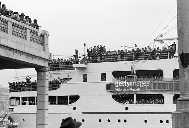 The Italian ship Conte Grande crowded with Italian emigrants leaving Genoa for Argentina Genoa February 1 1952