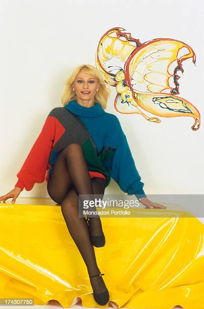The Italian showgirl Raffaella Carrà born Raffaella Maria Roberta Pelloni poses crossing her legs 1982