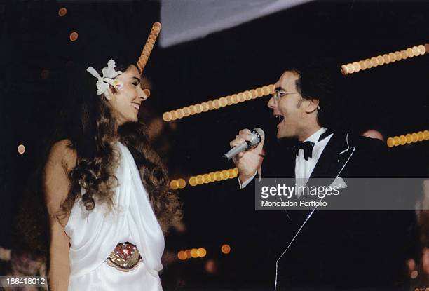 The italian singer Al Bano born Albano Carrisi and his wife the american singer Romina Power smile and sing the stage of Sanremo Music Festival The...