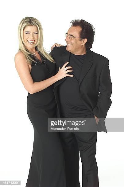 The italian singer Al Bano born Albano Carrisi jokes with his partner the showgirl Loredana Lecciso on February 22 2002