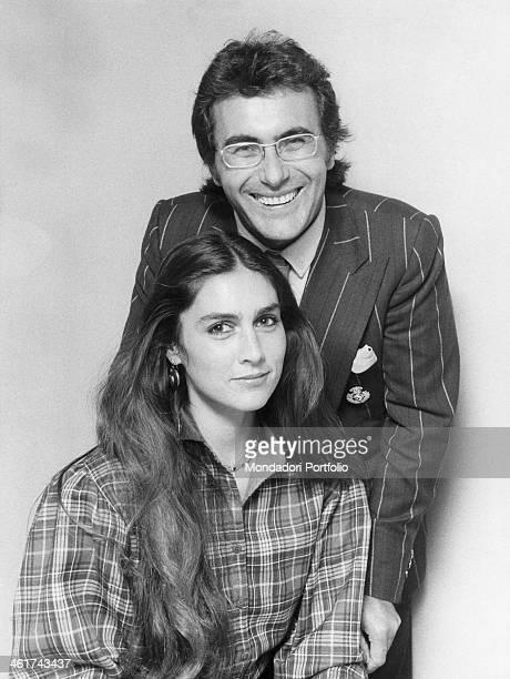 The italian singer Al Bano born Albano Carrisi smiles near his wife the american singer Romina Power during the sanremo Music Festival Sanremo Italy...