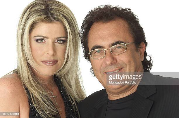 The italian singer Al Bano born Albano Carrisi smiles with his partner the showgirl Loredana Lecciso on February 22 2002